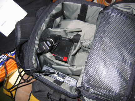 As setup in camera bag with battery and power adapter.